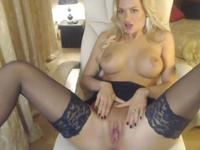 Perfectly shaved blonde getting out of lingerie