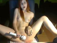 A pale red head masturbates in her room