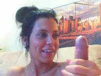 A dark haired slut jerks off a cock