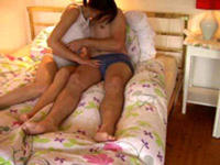 Young couple misbehaving in bed