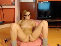 Hot blonde with glasses is naked for us