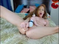 Redhead is using a vibrator