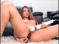 Brunette is massaging her pussy with a vibrator