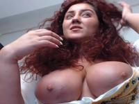 Curly redhead is having some fun