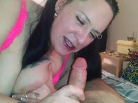 Milf licks her large tits