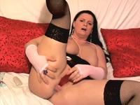 Busty woman opens up her legs
