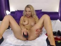 Blonde sticks a dildo inside her
