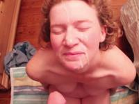 A slut is cumshot in her face