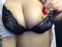 A chick with large tits is filmed