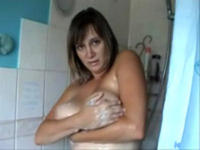 British milf soaps up her epic boobs