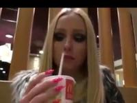 Blonde sucks cock in a cafe and gets cum in her mouth