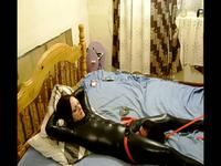 Tied up slave in latex
