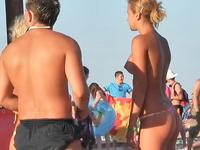 Topless bikini girl talking to the guy paying no attention he is staring at her boobs