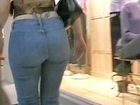 The well shaped bimbo in tight blue jeans is quickly walking in front of my spy camera