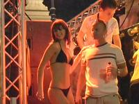 Perfectly shaped amateur gal in the hot micro bikini dancing at the fierce beach party