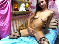 Petite brunette webcam model posing