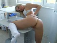 Perky blonde in white toys her snatch