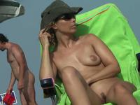 Delicious nudist milf cooch at the beach