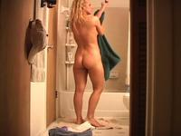Sexy blonde taking a shower and enjoying herself