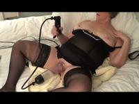 Milf in stockings and lingerie plays with her pussy pump