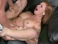 Strawberry blonde sucking off a muscular dude.